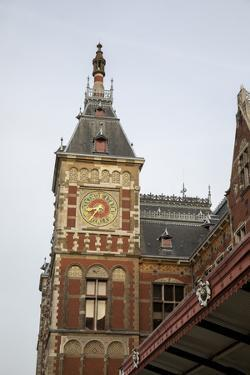 Europe, Netherlands, Amsterdam. Looking up at clock tower of Central Station. by Jaynes Gallery