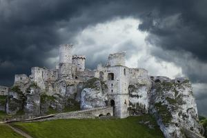 Europe, Poland. Storm clouds over Ogrodzieniec Castle. by Jaynes Gallery