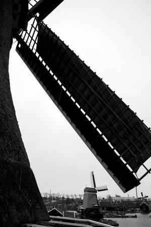 Netherlands, Zaanse Schans. Poelenburg woodmill and spicemill seen between sails of The Cat dyemill