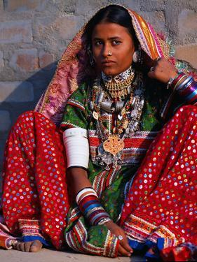 Ornately Dressed Megwar Tribe Woman Sits Next to Wall, Gujurat, India by Jaynes Gallery