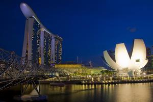 Singapore. Nighttime downtown waterfront architecture. by Jaynes Gallery