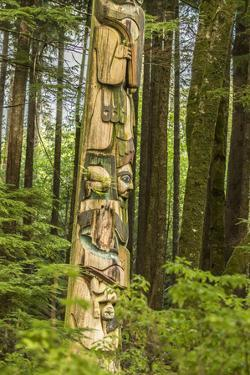 USA, Alaska, Prince of Wales Island, Kasaan. Totem pole and forest. by Jaynes Gallery