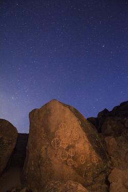 USA, California, Owens Valley. Native American petroglyphs at night. by Jaynes Gallery