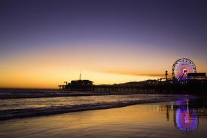 USA, California, Santa Monica. Ferris wheel and Santa Monica Pier at sunset. by Jaynes Gallery