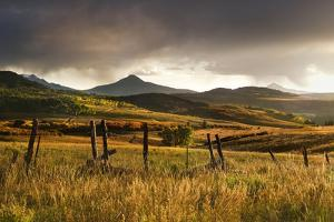 USA, Colorado, San Juan Mountains. Landscape and Fence at Sunset by Jaynes Gallery
