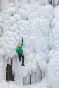 USA, Colorado, Uncompahgre National Forest. Climber ascends ice-encrusted cliff face. by Jaynes Gallery
