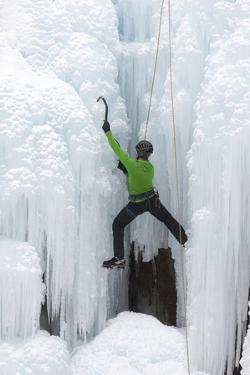 USA, Colorado, Uncompahgre National Forest. Climber ascends icy cliff face. by Jaynes Gallery