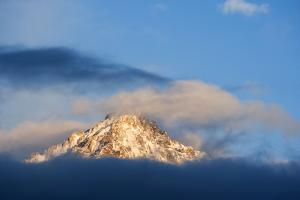 USA, Idaho, Sawtooth Range. Sunlit mountain and clouds. by Jaynes Gallery