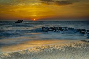 USA, New Jersey, Cape May National Seashore. Sunrise on ocean shore. by Jaynes Gallery