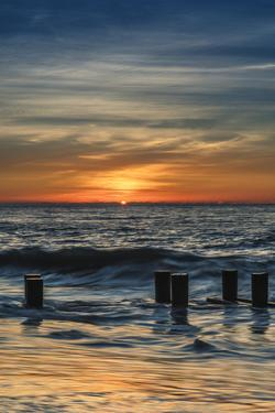 USA, New Jersey, Cape May National Seashore. Sunrise on winter shoreline. by Jaynes Gallery