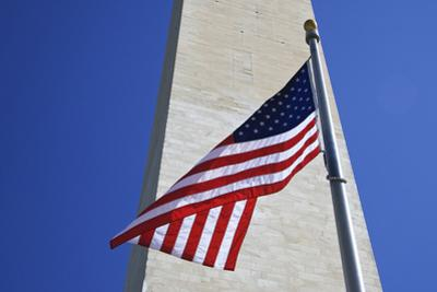 USA, Washington DC. American flag and the Washington Monument. by Jaynes Gallery