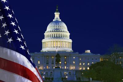 USA, Washington DC. Capitol Building and US flag at night. by Jaynes Gallery