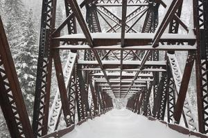 USA, Washington, Leavenworth. Snow-covered Pipeline Bridge superstructure. by Jaynes Gallery