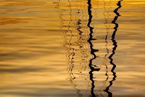 USA, Washington, San Juan Islands. Sailboat mast reflection at sunset. by Jaynes Gallery