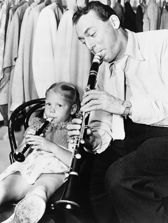 Jazz Musician Woody Herman Playing His Clarinet While His Daughter Ingrid Plays a Plastic Flute