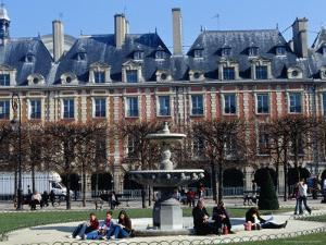 People Relaxing Around Fountain in Place Des Vosges by Jean-Bernard Carillet