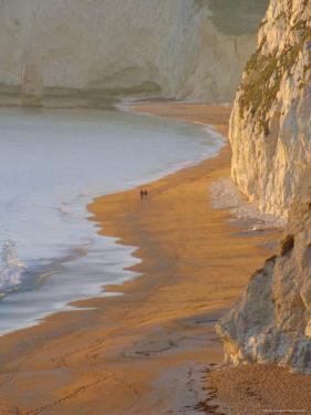 Couple Walking on Beach. Isle of Purbeck, Dorset, England UK by Jean Brooks