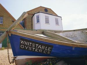 Fishing Boat on the Beach, England, UK. Whitstable is Popular for It's Oyster and Fish Restaurants. by Jean Brooks