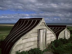 Upturned Boats Used as Sheds, Lindisfarne (Holy Island), Northumbria, England by Jean Brooks
