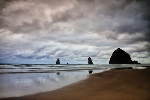 USA, Oregon, Cannon Beach. Haystack Rock at Low Tide by Jean Carter