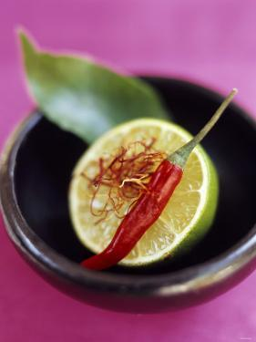 Still Life with Lime, Chili, Saffron and Kaffir Lime Leaf by Jean Cazals