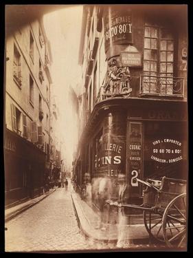 Rue Des Nonnains D'HyŠres with a Wine Merchant by Jean EugŠne Auguste Atget