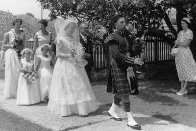 https://imgc.allpostersimages.com/img/posters/jean-ewen-s-wedding-with-four-mckenzie-cousins-c-1956_u-L-PPXVUH0.jpg?p=0