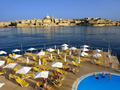 Valletta Skyline with Tourists Relaxing around Pool in Foreground