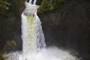 A Daring Kayaker Going over Abiqua Falls into the Pool Below by Jed Weingarten