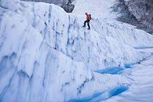 A Man Climbing on a Glacial Formation by Jed Weingarten