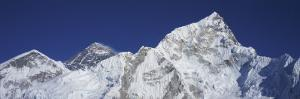 Detail of Mount Everest and Nuptse Against Blue Sky by Jeff Foott