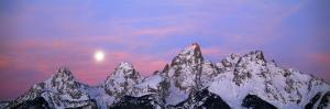 Moon Begins its Descent as the Sun Rises and Casts Pink Light across Teton Range by Jeff Foott
