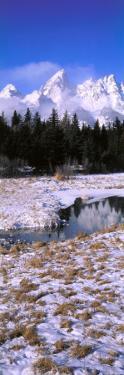 Reflection of Teton Range in Spring Creek in Early Winter by Jeff Foott