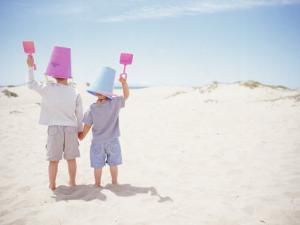 2 Boys with Sand Bucket Over Their Heads by Jeff Greenberg