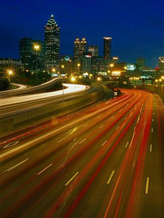 Downtown at Dusk with Traffic, Atlanta, GA by Jeff Greenberg
