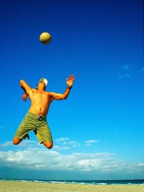 Man Playing Volleyball, FL by Jeff Greenberg