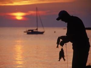 Silhouette of Man Fishing, Lake Erie, Lorain, OH by Jeff Greenberg