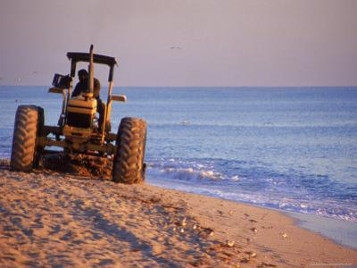 Tractor Plowing Beach, Miami Beach, FL by Jeff Greenberg