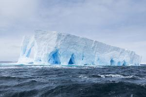 A Natural Arch Formation Inside a Tabular Iceberg by Jeff Mauritzen