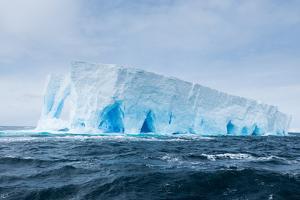 A Tabular Iceberg Floats in the Drake Passage, Antarctica by Jeff Mauritzen