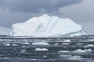 An Iceberg Floats in Fournier Bay, Antarctica by Jeff Mauritzen