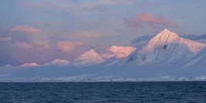 Snowcapped Mountain Along the Gerlache Strait, Antarctica by Jeff Mauritzen