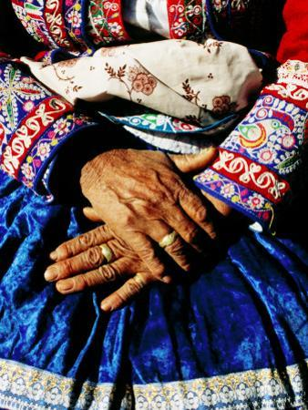 Close-Up of Hands of Woman Wearing Traditional Clothes
