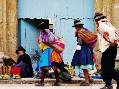 Family Walking Through Market, Lircay, Peru by Jeffrey Becom