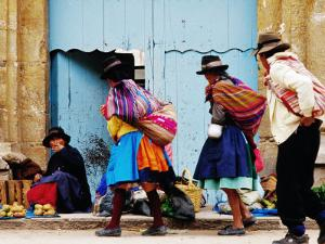 Family Walking Through Market, Lircay, Peru by Jeffrey Becom