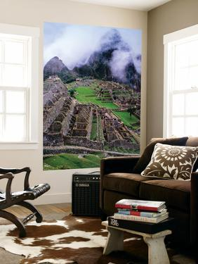 Fog Above Terraced Inca Ruins by Jeffrey Becom