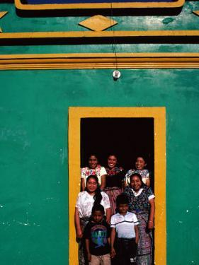Painted House with Children Posing in the Doorway, Momostenango, Totonicapan, Guatemala by Jeffrey Becom