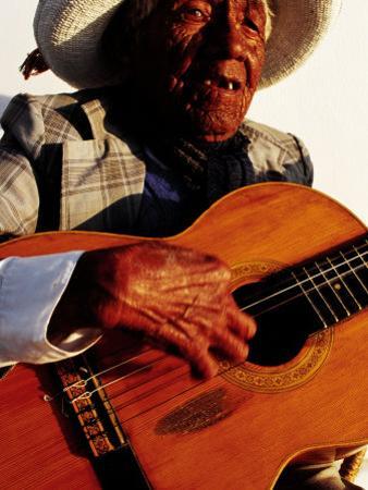 Portrait of Old Man Playing Guitar, Paracas, Peru by Jeffrey Becom