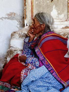 Profile of Woman in Traditional Embroidered Dress at Mass, Yanque, Peru by Jeffrey Becom