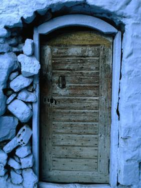 Wooden Door in Rubblestone Wall, Kalymnos, Greece by Jeffrey Becom